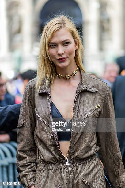 Model Karlie Kloss wearing cropped top and overall outside Lanvin on September 28 2016 in Paris France