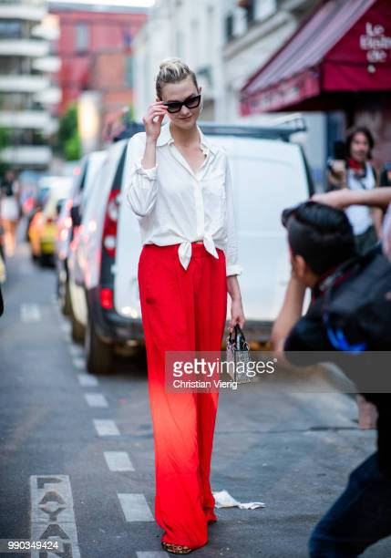 Model Karlie Kloss wearing white blouse red flared pants is seen outside Dundas on day two during Paris Fashion Week Haute Couture FW18 on July 2...