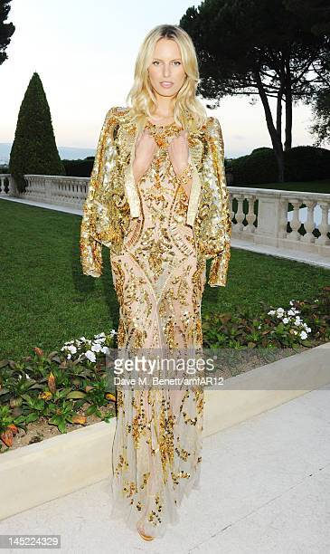 Model Karolina Kurkova attends the 2012 amfAR's Cinema Against AIDS during the 65th Annual Cannes Film Festival at Hotel Du Cap on May 24 2012 in Cap...
