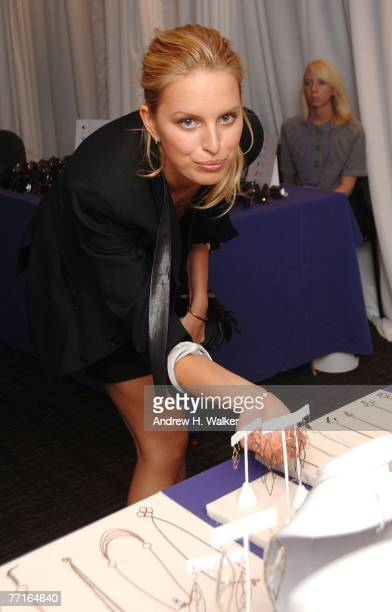 Model Karolina Kurkova looks at jewelry at the VIP sample sale hosted by herself the Accessories Council and InStyle Magazine on October 2 2007 in...