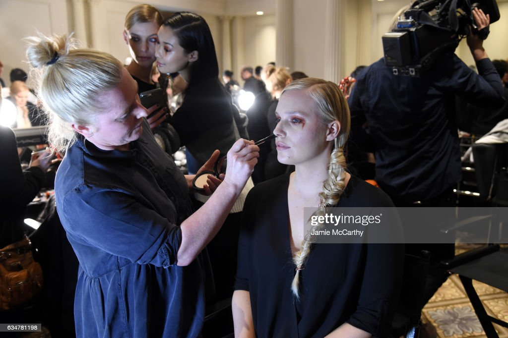 Model Karolina Kurkova prepares backstage for the Christian Siriano show during, New York Fashion Week: The Shows at The Plaza Hotel on February 11, 2017 in New York City.