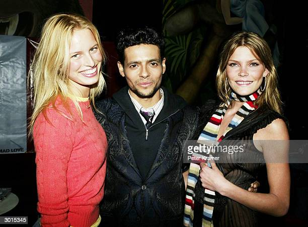 Model Karolina Kurkova Robi Rosa and model May Anderson attend a concert performed by ex Menudo singer Robi Rosa at The Supper Club February 25 2004...