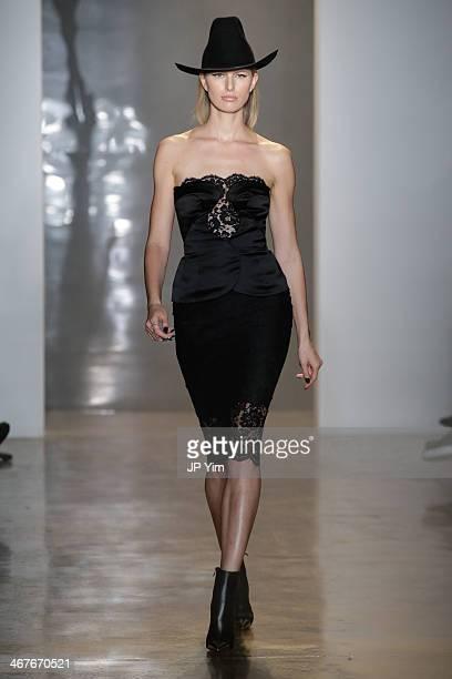 Model Karolina Kurkova walks the runway at Cushnie Et Ochs during MADE Fashion Week Fall 2014 at Milk Studios on February 7 2014 in New York City
