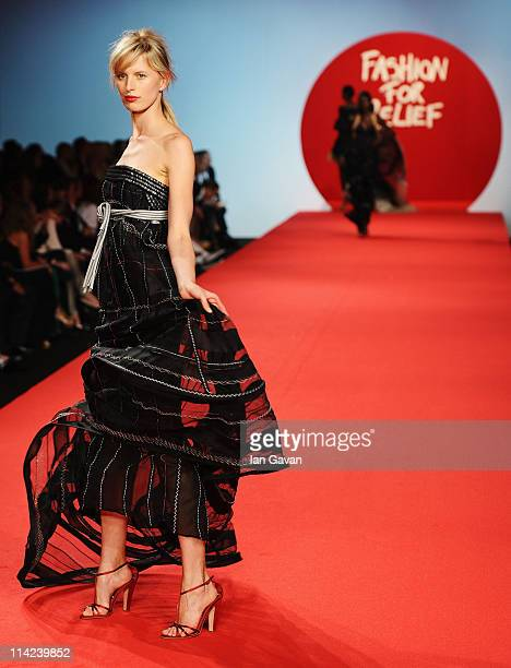 Model Karolina Kurkova walks the runway at the Fashion For Relief at Forville market during the 64th Annual Cannes Film Festival on May 16, 2011 in...