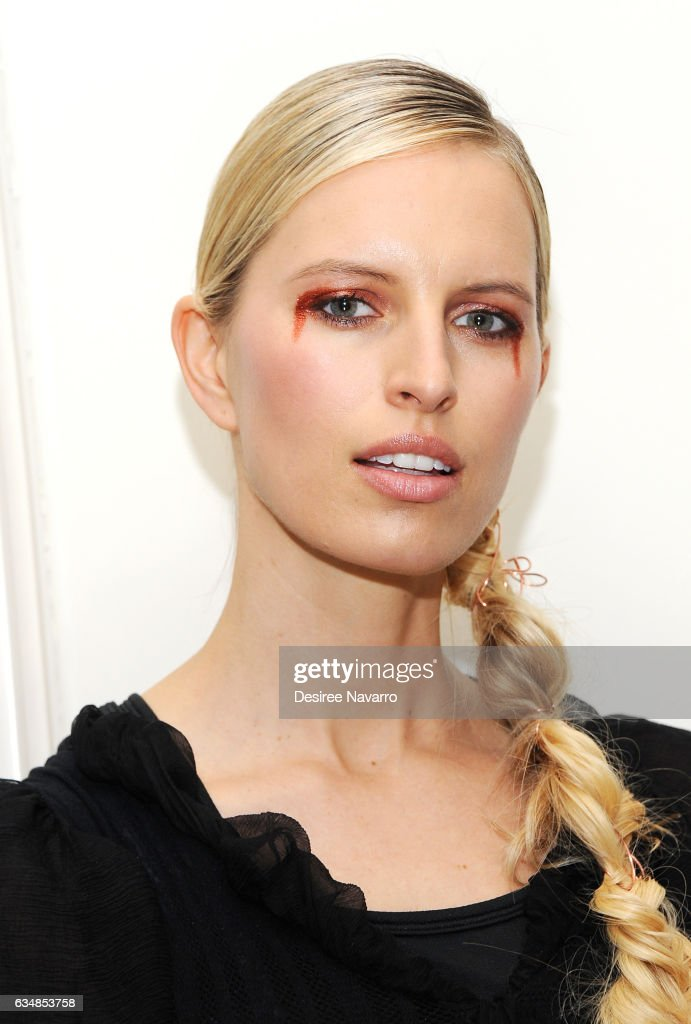 Model Karolina Kurkoval poses backstage at the Christian Siriano show during, New York Fashion Week: The Shows at The Plaza Hotel on February 11, 2017 in New York City.