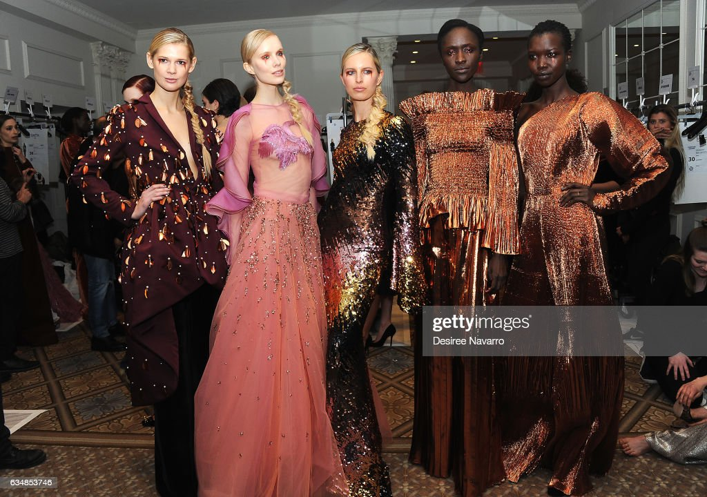 Model Karolina Kurkoval (C) poses backstage with models at the Christian Siriano show during, New York Fashion Week: The Shows at The Plaza Hotel on February 11, 2017 in New York City.