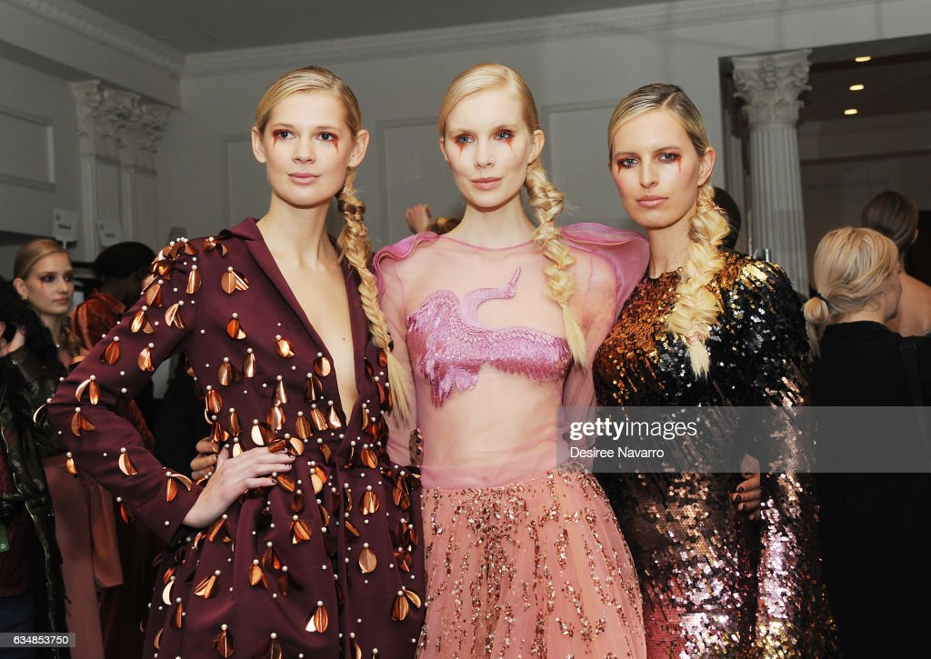 Model Karolina Kurkoval (R) poses with models backstage at the Christian Siriano show during, New York Fashion Week: The Shows at The Plaza Hotel on February 11, 2017 in New York City.