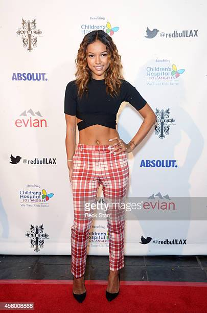 Model Karrueche Tran attends The Abbey Food Bar's 9th Annual Christmas In September event at The Abbey on September 23 2014 in West Hollywood...