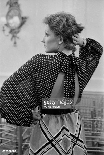 Model Kasia wearing a patterned skirt and backless polka dot blouse from the Hardy Amies Spring Collection 18th January 1972