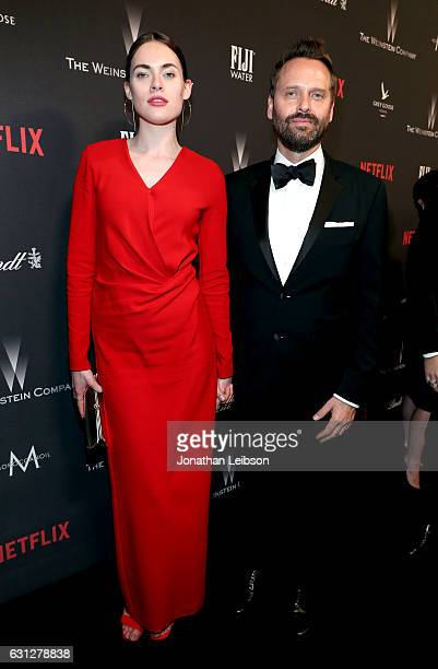 Model Kassandra Jensen and composer Dustin O'Halloran pose at The Weinstein Company and Netflix Golden Globes Party presented with FIJI Water at The...
