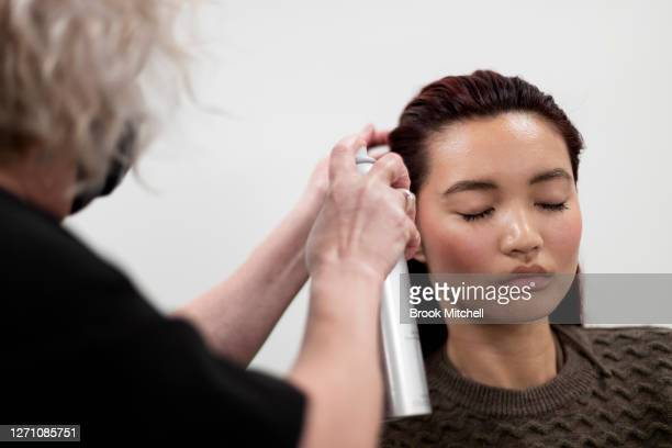 Model Kat Wu prepares backstage ahead of the David Jones SS20 New Dawn Season Launch at David Jones Elizabeth Street Store on September 07 2020 in...