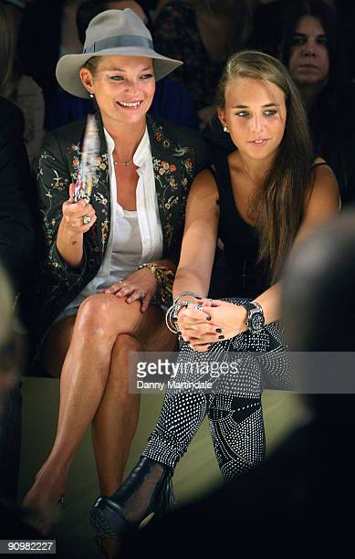Model Kate Moss and Chloe Green attend the Topshop Unique show at London Fashion Week Spring/Summer 2010 Runway on September 20 2009 in London United...