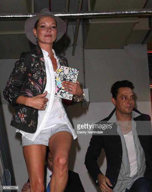 Model Kate Moss and musician Jamie Hince attend the Topshop Unique show at London Fashion Week Spring/Summer 2010 Runway on September 20 2009 in...