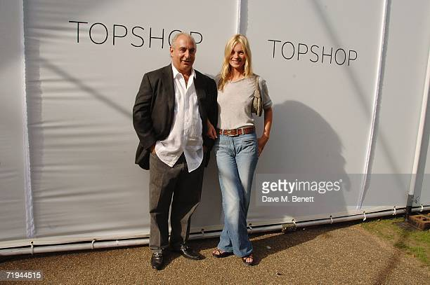 Model Kate Moss and retail businessman Sir Philip Green attend the Topshop Fashion Show in Holland Park on September 17, 2006 in London, England....