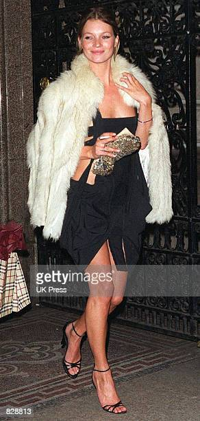 Model Kate Moss arrives at the opening of the Mario Testino photography exhibition January 29 2002 at the National Portrait Gallery in London The...