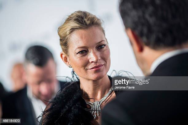 Model Kate Moss arrives on the red carpet during the 2015 amfAR Hong Kong gala at Shaw Studios on March 14 2015 in Hong Kong