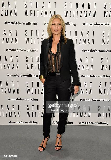Model Kate Moss attends the Kate Moss Celebrates Stuart Weitzman Flagship Store Opening Designed By Zaha Hadid as a part of Milan Fashion Week...