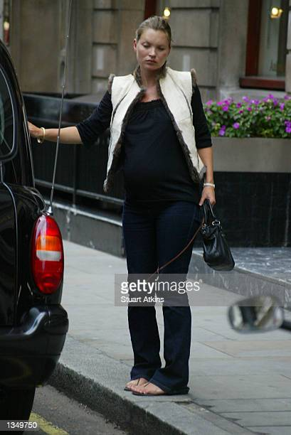 Model Kate Moss exits a car before walking to Wiltons Restaurant August 22 2002 in London England
