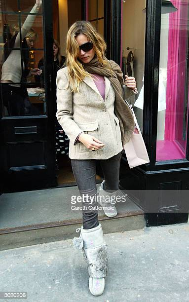 Model Kate Moss exits a shop on February 27 2004 in London