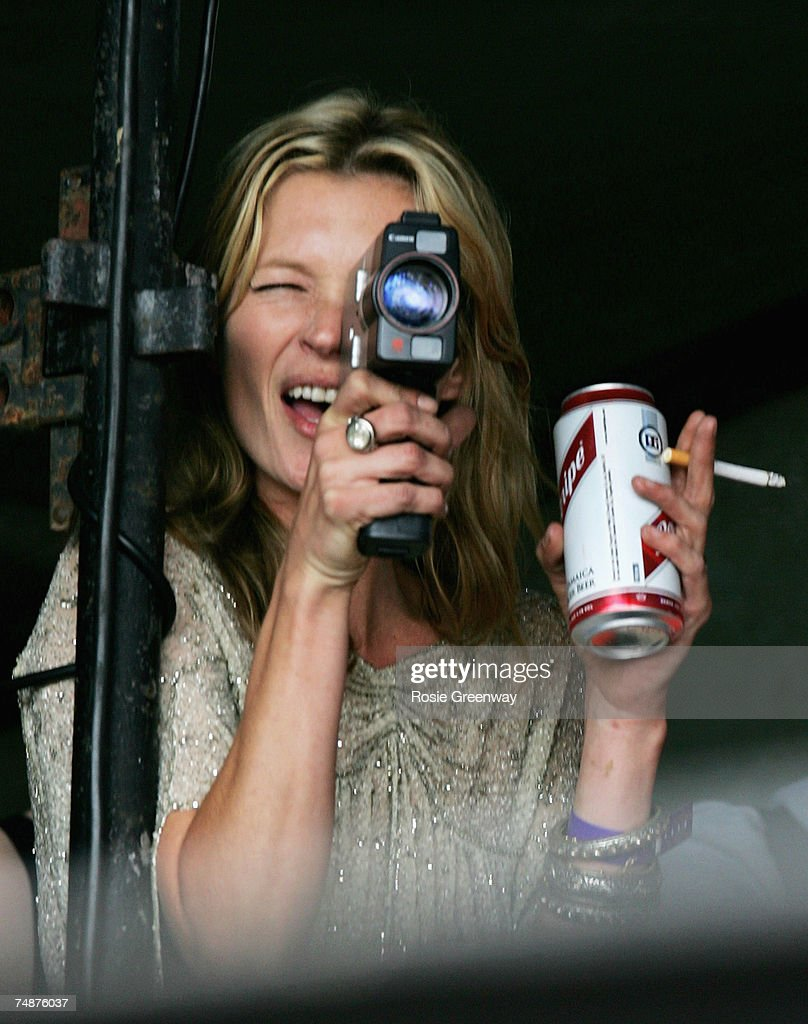 Model Kate Moss films boyfriend Pete Doherty (unseen) on the Park acoustic stage on the second day of the Glastonbury Festival at Worthy Farm, Pilton near Glastonbury, on June 24, 2007 in Somerset, England. The Festival, started by dairy farmer Michael Eavis in 1970, has grown into the largest music festival in Europe.