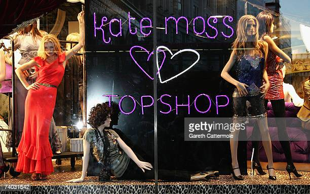 Model Kate Moss is seen in the window of Top Shop on Oxford Street as she launches the Kate Moss collection on April 30, 2007 in London.