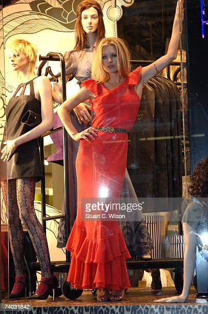 Model Kate Moss poses in the window of Top Shop on Oxford Street to launch her own clothing range on April 30, 2007 in London, England.