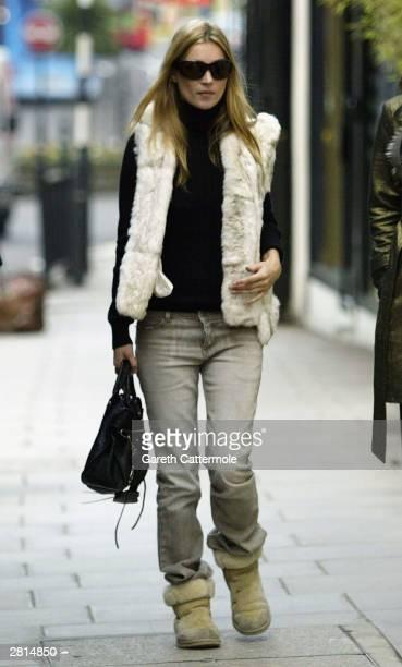 Model Kate Moss takes a walk on December 16, 2003 in West London.