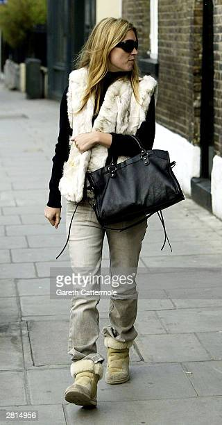 Model Kate Moss takes an afternoon strool on December 16 2003 in West London