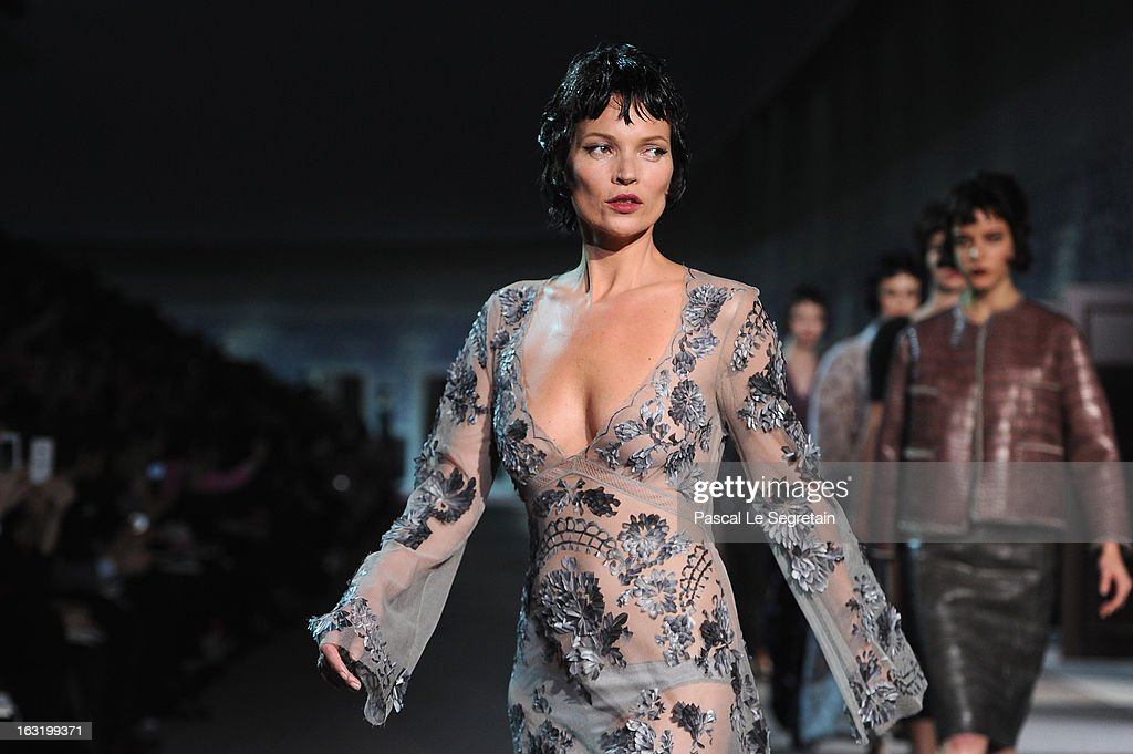 Model Kate Moss walks the runway during Louis Vuitton Fall/Winter 2013 Ready-to-Wear show as part of Paris Fashion Week on March 6, 2013 in Paris, France.