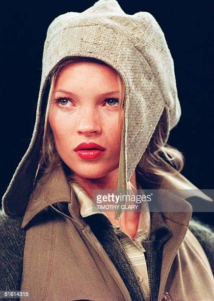 Model Kate Moss wears a flapped hat with a suede jacket 07 April 1994 during the showing of the Fall 1994 Anne Klein collection