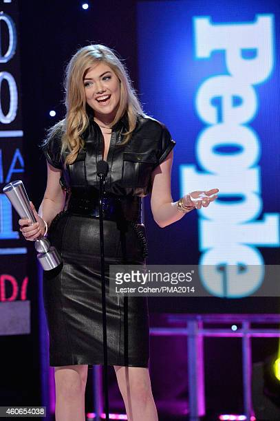 Model Kate Upton accepts PEOPLE's Sexiest Woman award onstage during the PEOPLE Magazine Awards at The Beverly Hilton Hotel on December 18 2014 in...