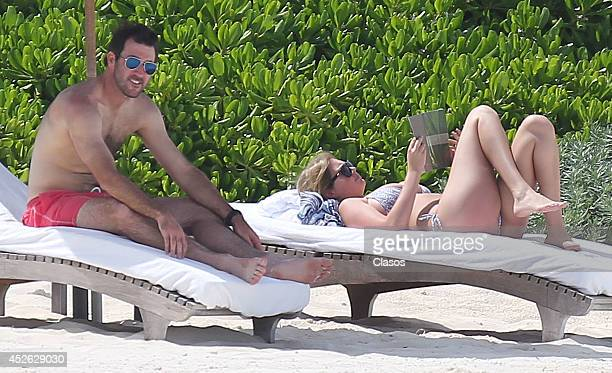 Model Kate Upton and her boyfriend Justin Verlander relax in the sun in Cancun on July 14 2014 in Cancun Mexico