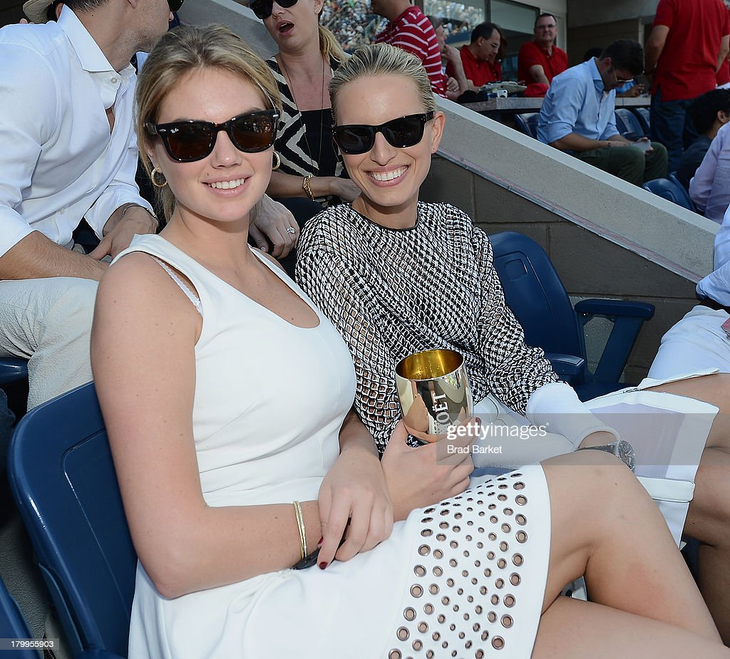 Model Kate Upton (L) and Karolina Kurkova attend The Moet & Chandon Suite at USTA Billie Jean King National Tennis Center on September 7, 2013 in New York City.