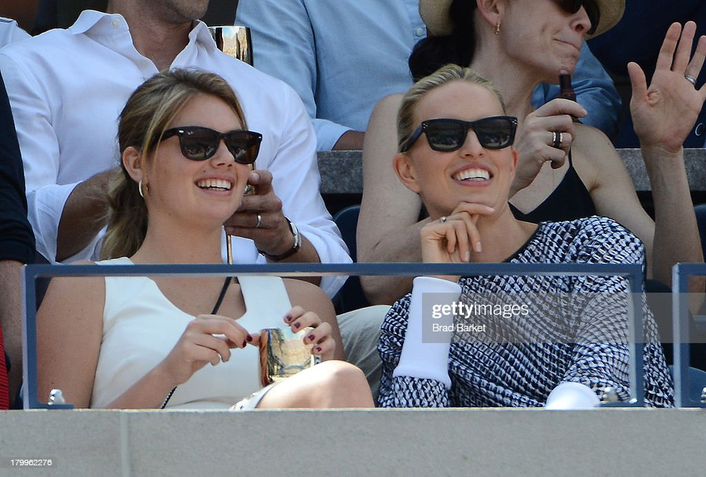 Model Kate Upton(L) and Karolina Kurkova attend The Moet & Chandon Suite at USTA Billie Jean King National Tennis Center on September 7, 2013 in New York City.