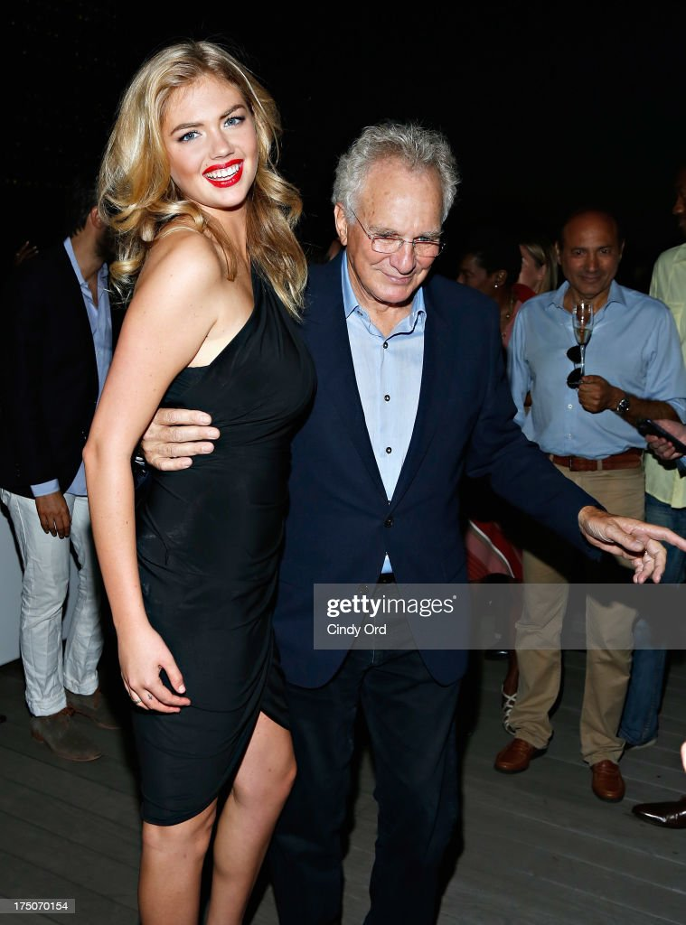 Model Kate Upton dances with jeweler David Yurman at the David Yurman Annual Rooftop Soiree at David Yurman Rooftop on July 30, 2013 in New York City.
