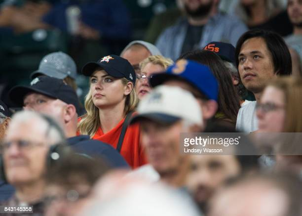 Model Kate Upton in red the fiancee of Justin Verlander of the Houston Astros watches the game against the Seattle Mariners at Safeco Field on...