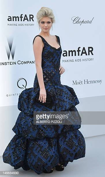 Model Kate Upton poses as she arrives to attend the 2012 amfAR's Cinema Against Aids on May 24, 2012 in Antibes, southeastern France. AFP PHOTO /...
