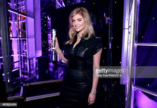Model Kate Upton poses with the award for People's Sexiest Woman backstage during the PEOPLE Magazine Awards at The Beverly Hilton Hotel on December...