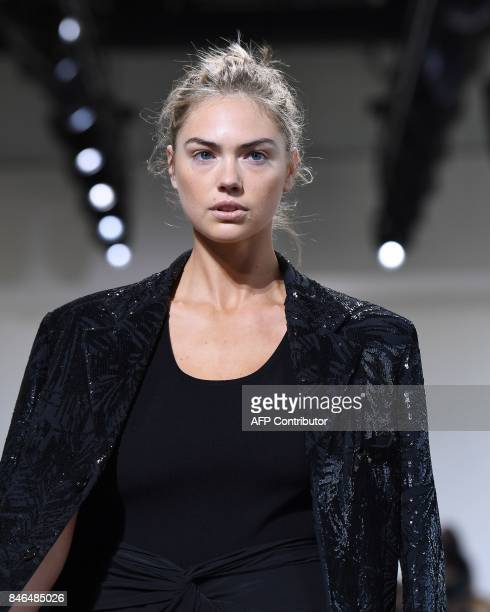 Model Kate Upton walks the runway for the Michael Kors Collection Spring 2018 Runway Show at Spring Studios on September 13 during New York Fashion...
