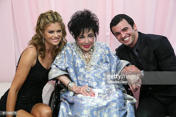 Model Kathy Ireland Dame Elizabeth Taylor and dancer Tony Dovolani pose backstage during the Macy's Passport gala held at Barker Hangar on September...