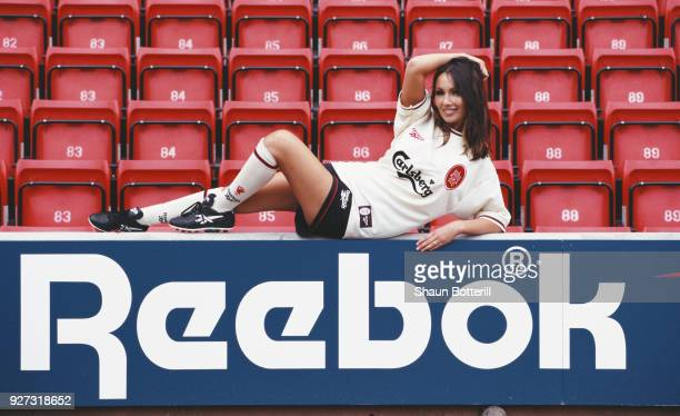 Model Kathy Lloyd poses in the new Liverpool change kit at the launch of the 1996/97 season Reebok strip at Anfield on July 8 1996 in Liverpool...