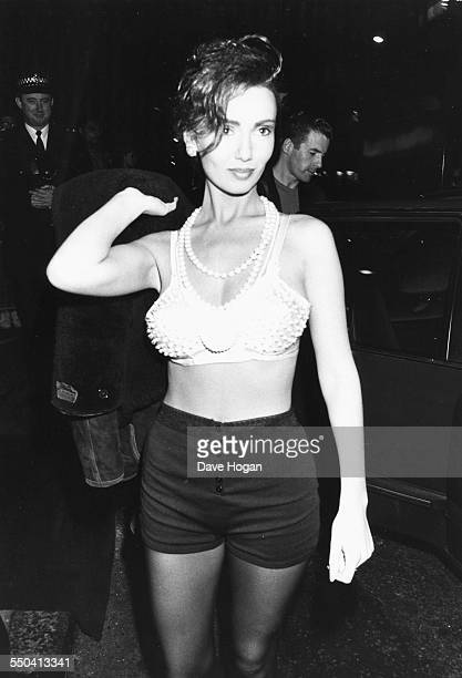 Model Kathy Lloyd wearing shorts and a bra as she arrives at Delinquent's circa 1985