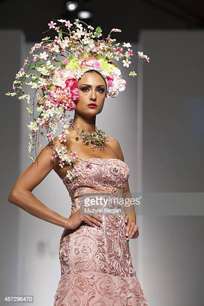 Model Katie Cleary on runway wearing SUE WONG at SUE WONG Spring 2015 Fairies Sirens Fashion Show on October 15 2014 in Los Angeles California