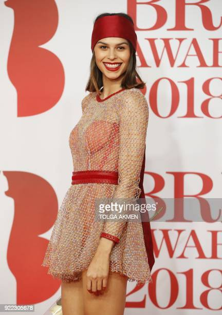 Model Katie Keight poses on the red carpet on arrival for the BRIT Awards 2018 in London on February 21 2018 / AFP PHOTO / Tolga AKMEN / RESTRICTED...