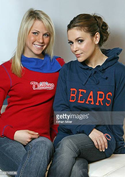 Model Katie Osborne and actress Alyssa Milano show new creations from Milano's fashion line TOUCH by Alyssa Milano at the GIII Apparel Group booth at...