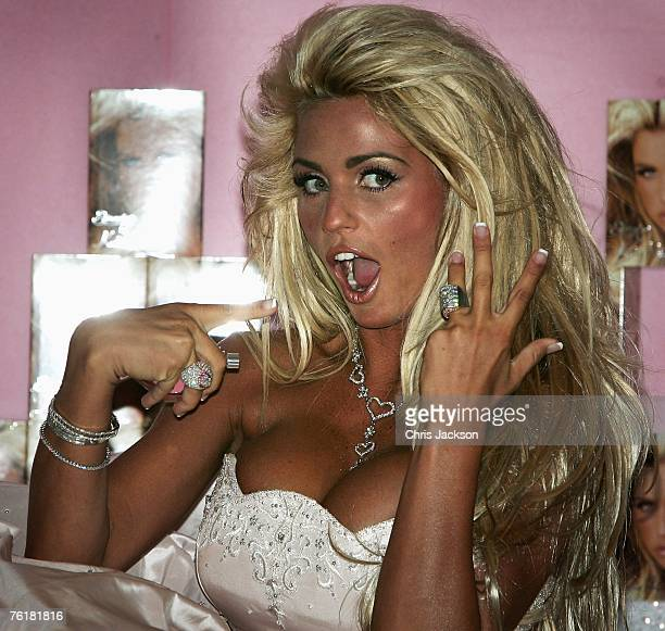 Model Katie Price shows off her wedding ring as she lauches her new perfume range 'Stunning' at the Kensington Roof Gardens on August 20 2007 in...