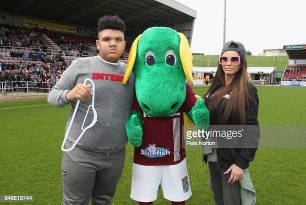 Model Katy Price and her son Harvey pose with Northampton Town mascot Clarence the Dragon prior to a Celebrity Charity Match at Sixfields on April 15...