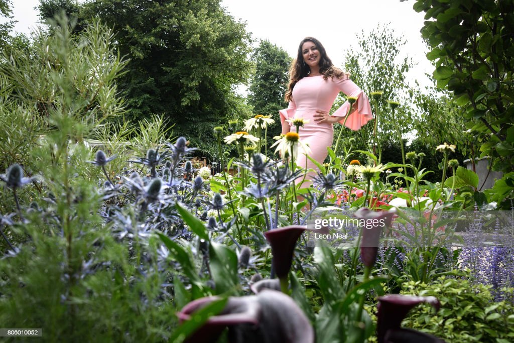 Model Kelly Brook poses for photographs at the 'On the Edge: The Centre for Mental Health Garden' on the press preview day of the Hampton Court Palace Flower Show at Hampton Court Palace on July 3, 2017 in London, England. Running from 4-9 July, the annual event sees gardeners and enthusiasts gather to see the latest garden designs and floral creations.
