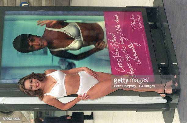 Model Kelly Brook poses for the media in front of the 3D moving speaking advertisement which features supermodel Helena Christiensen which she...
