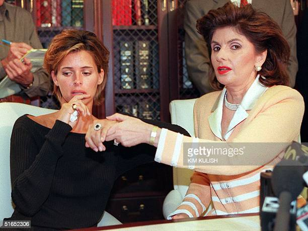US model Kelly Fisher and her attorney Gloria Allred show off the large sapphire and diamond engagement ring given to her by former Egyptian fiancee...
